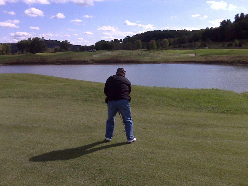 Dean golfing