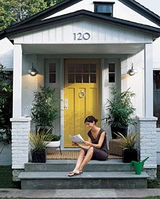 Yellow front doors are not for the faint of heart or Gray front door meaning