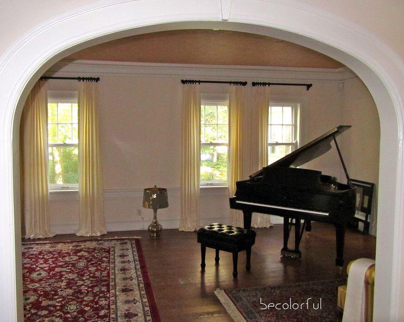 Living room redo draperies through arch