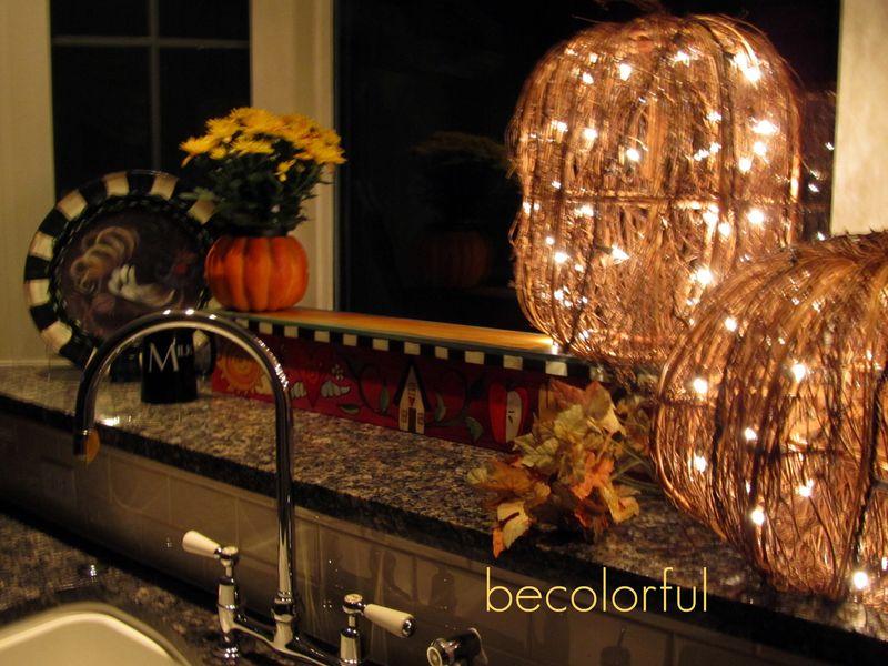 Fall flair 2010 lighted pumpkins kitchen window