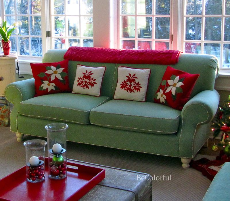 Green sofa and CandB pillows