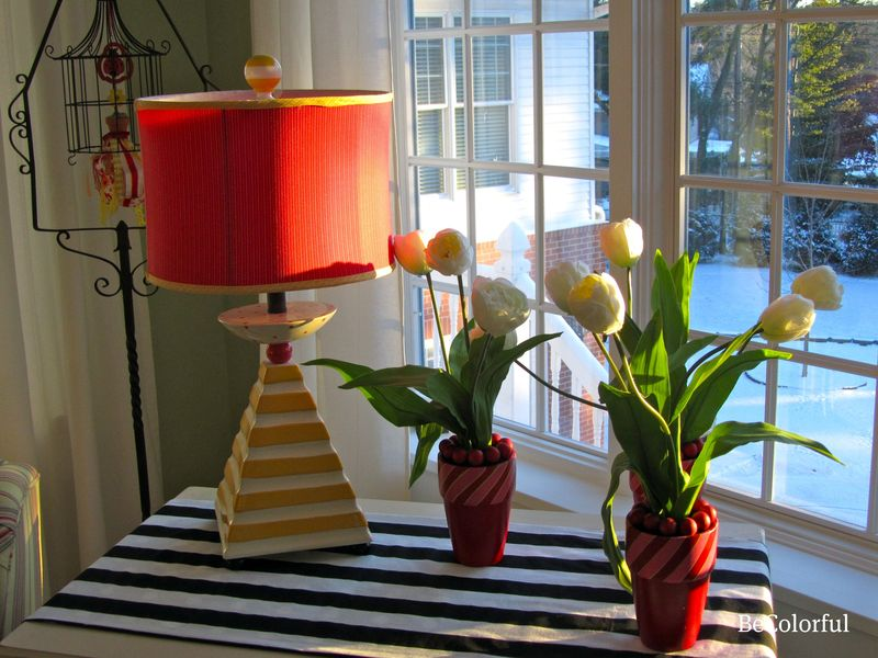 Red funky lamp and holiday tulips