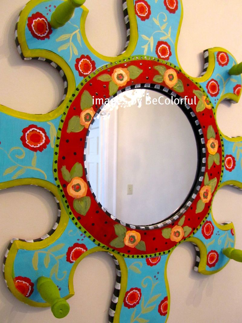 Muriels mirror with chandelier reflecting