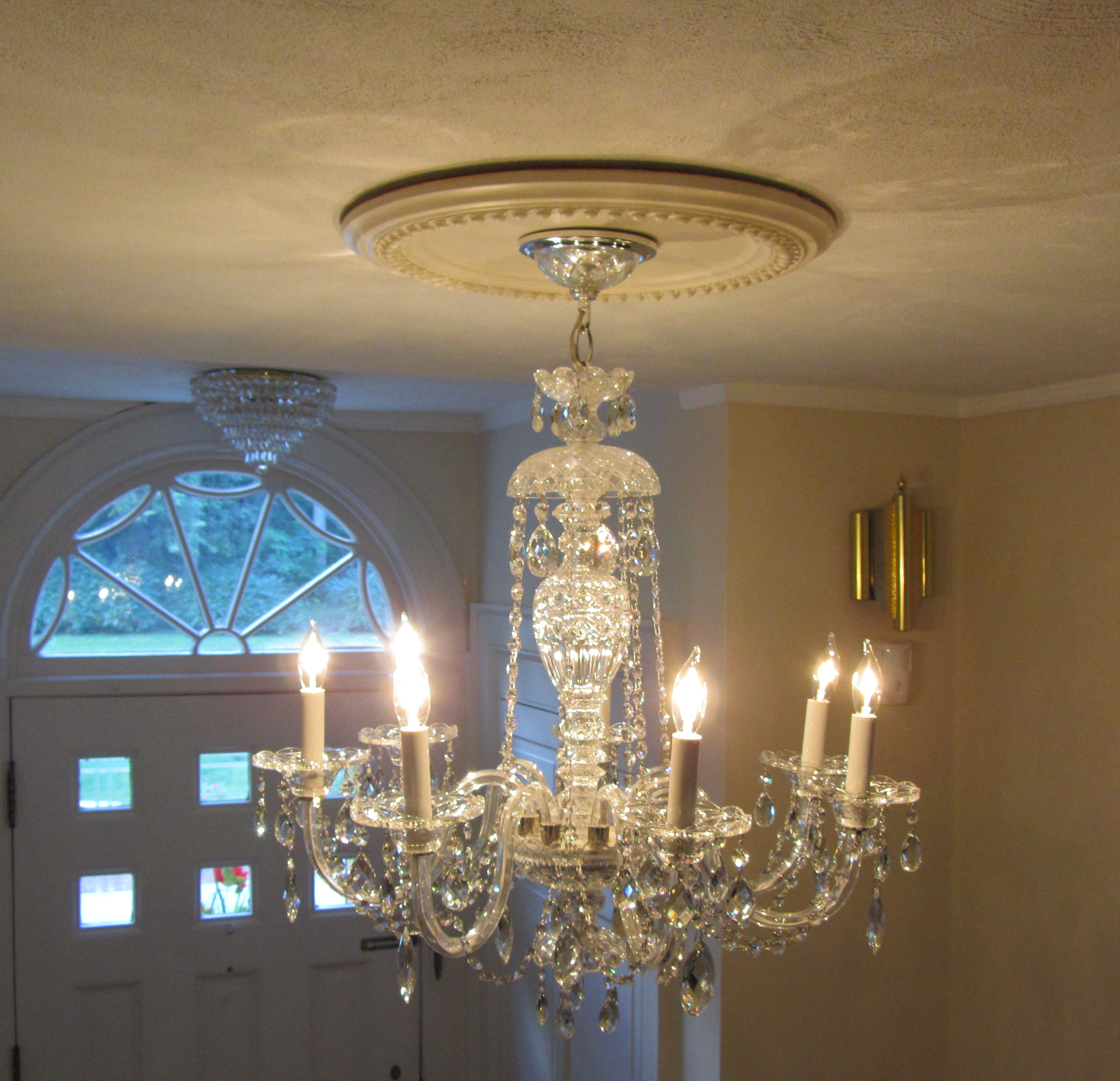 If There Is A Crystal Stem At The Center Of Your Chandelier Like This One Then Spray Bit Windex On Rag And Wipe Exposed Part