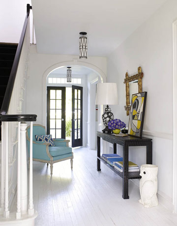 White foyer with color pops house beautiful