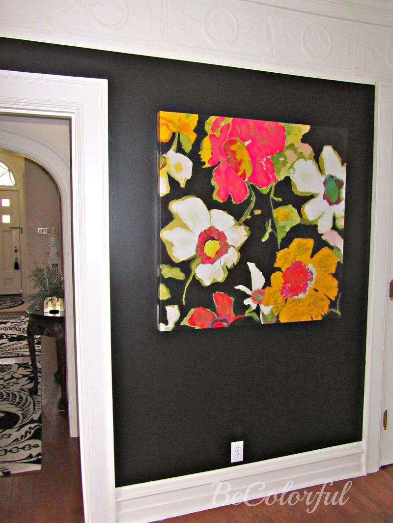 Black dining room with floral canvas.jpg