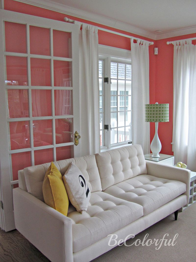 White sofa against coral walls.jpg