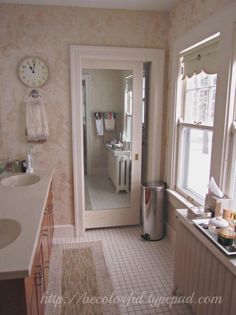 View into bath with pocket door closed