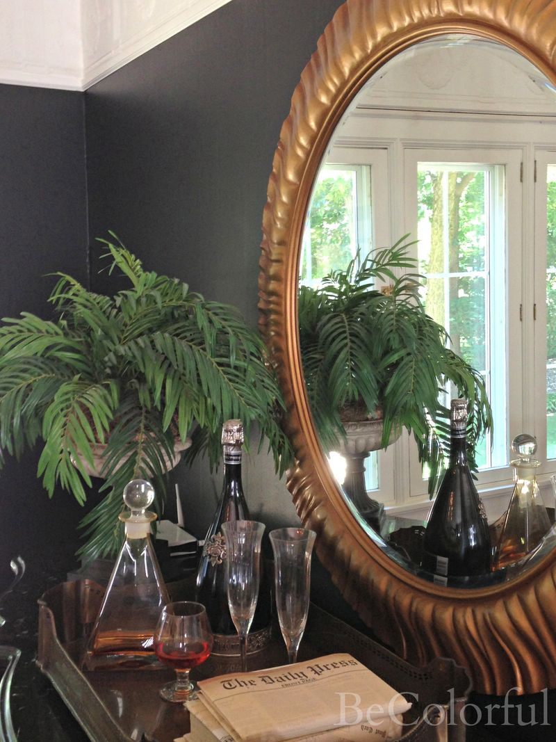 Dining room black round mirror close up.jpg