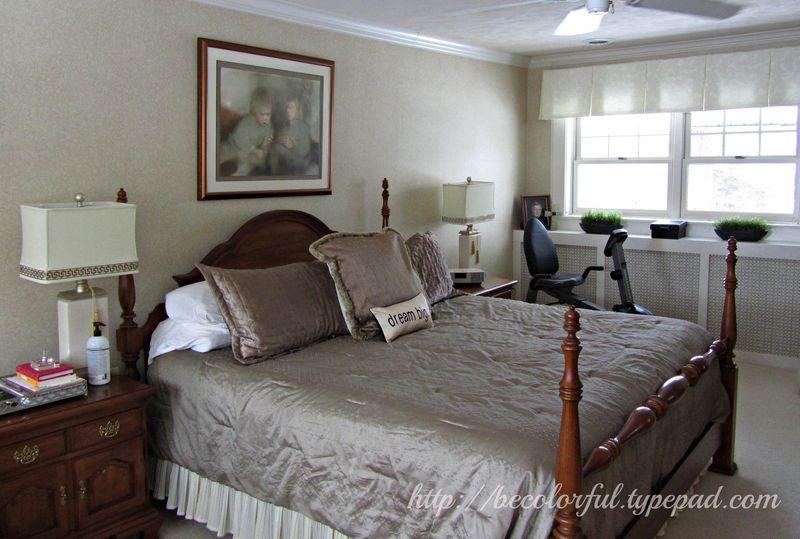 Bedroom before across bed toward bike