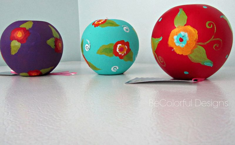 Set of three colorful globe candle holders.jpg
