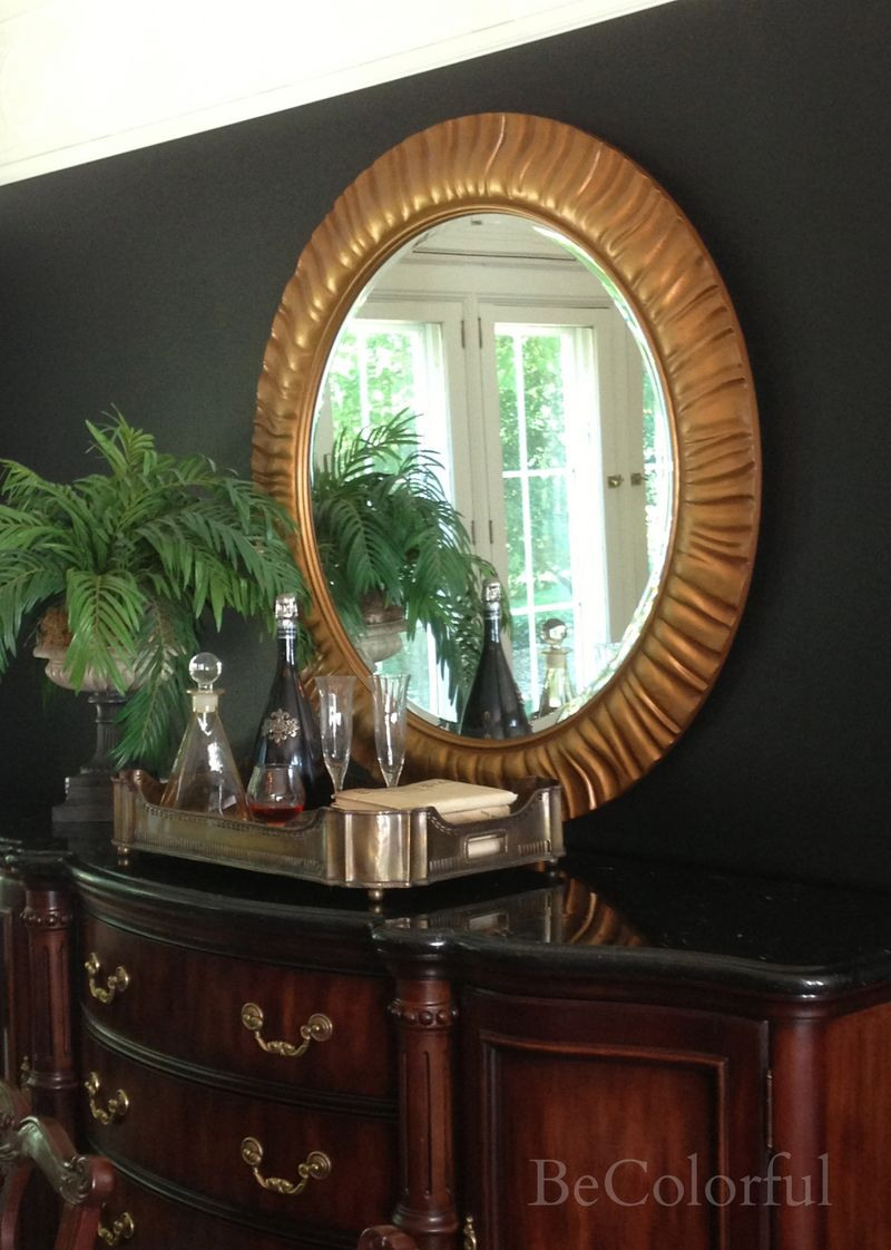 Dining room black round mirror from right