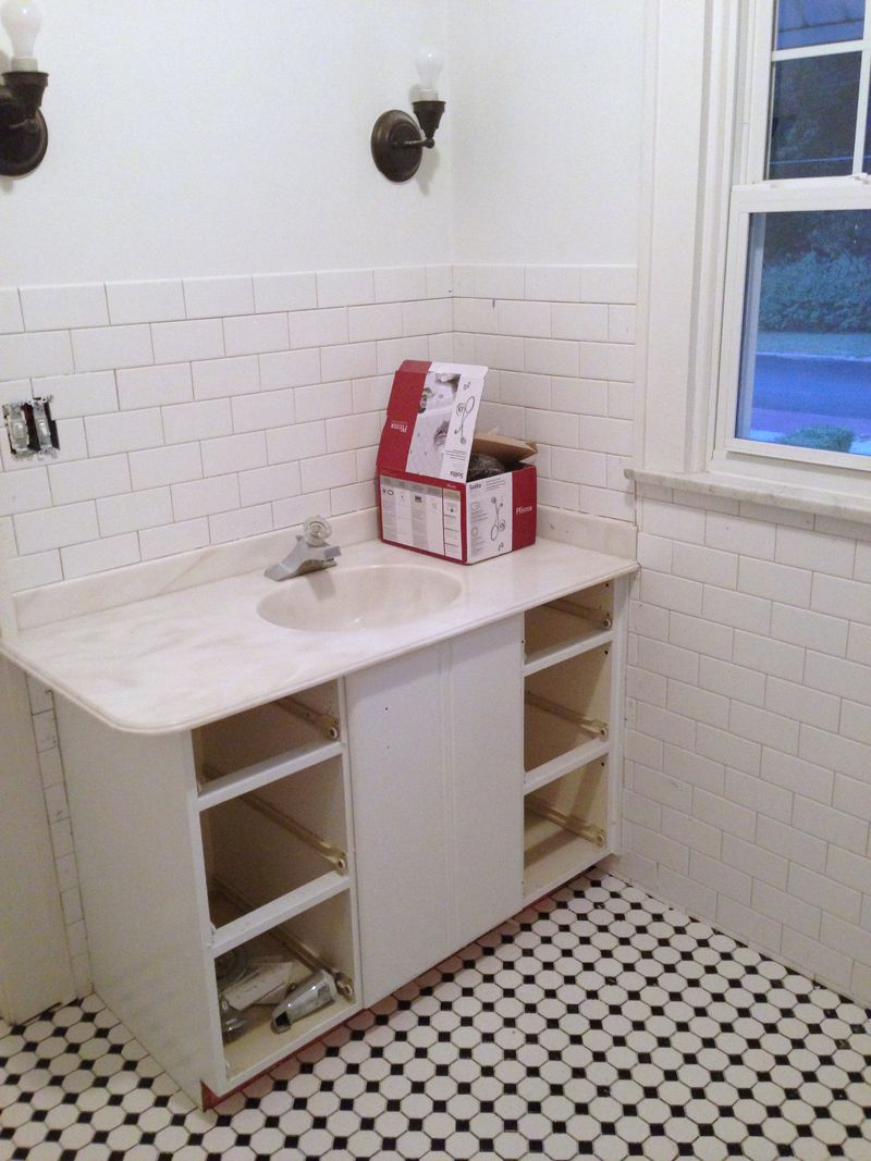 Jack and Jill bath tile before grout.jpg
