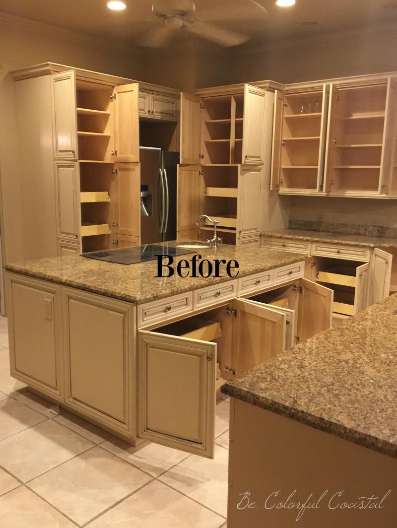 Empty kitchen cupboards before