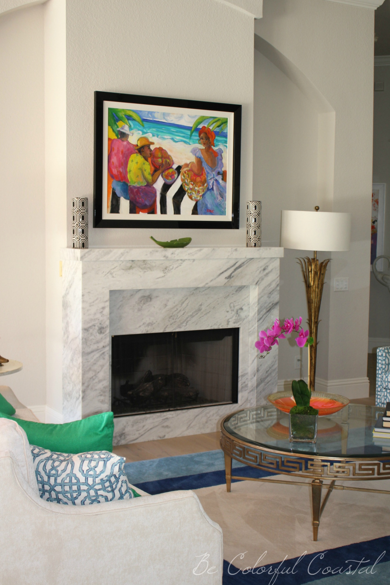 Balboa Mist wall color paired with tropical colors and marble fireplace