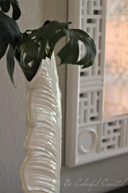 Close up of ceramic palm frond vase