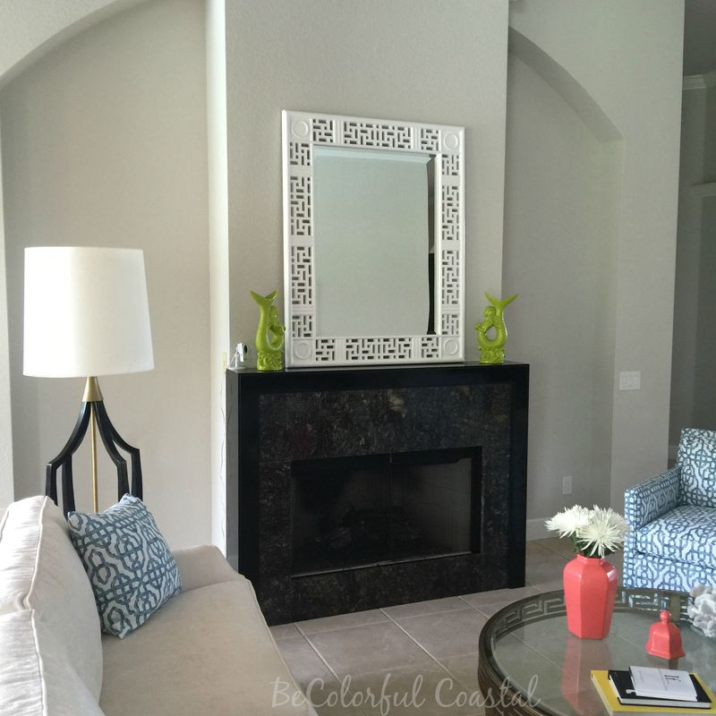 Toward fireplace with mirror