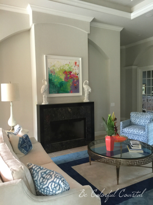 Blue and white living room with coral