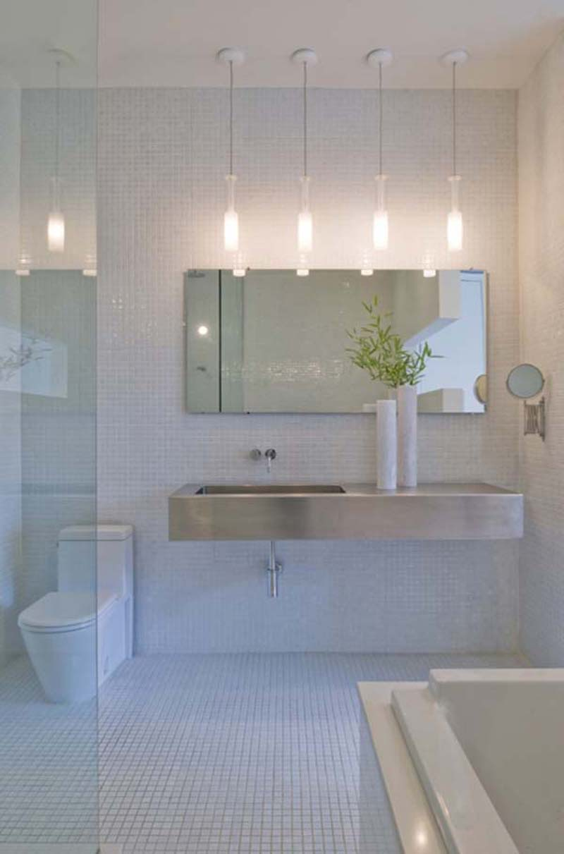 Small-Pendant-Lighting-Bathroom-Vanity-above-Casual-Vanity-closed-Simple-Mirror-on-Usual-Wall-Tile-and-White-Closet-on-Small-Floortile-facing-Walk-in-Shower