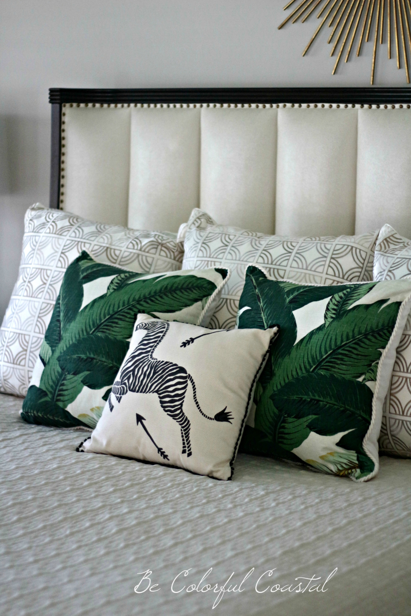 Close up of pillows and headboard from right