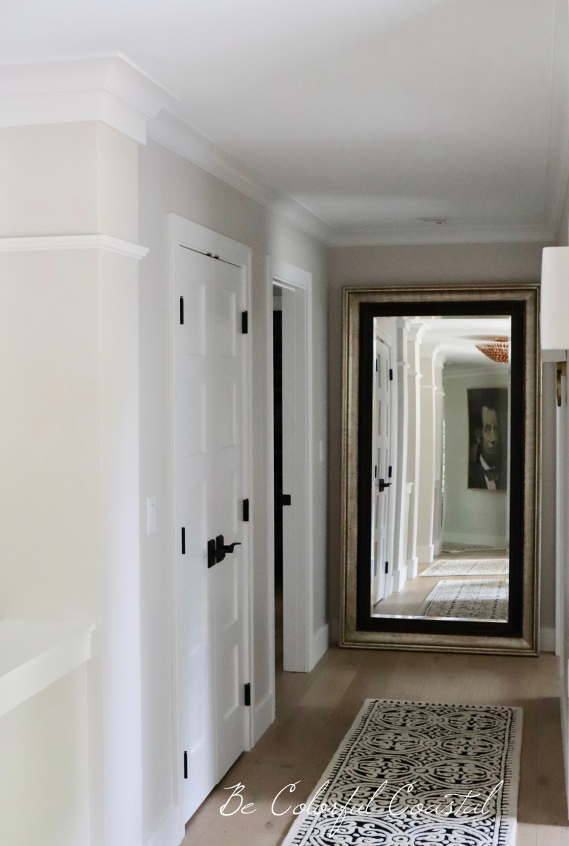 View of hallway toward mirror and closet doors