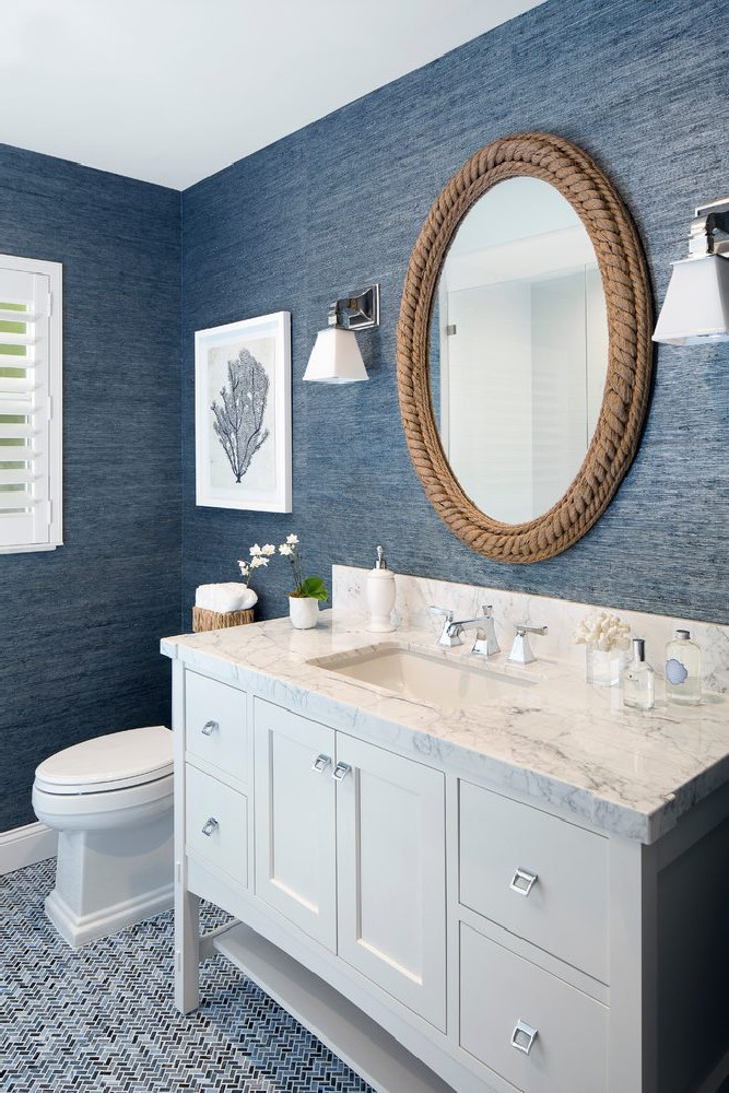 Blue grasscloth wallpapered bath