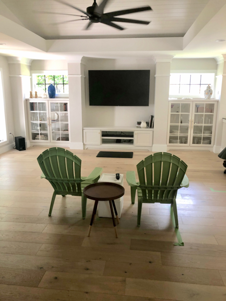 Great room reveal no furniture green chairs