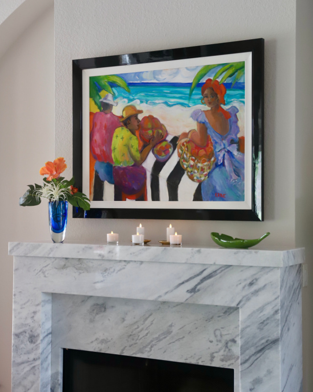 Fireplace with blue vase and lighted candles