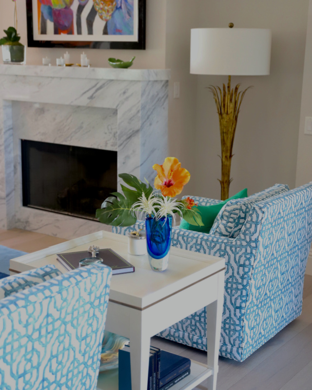 Living room chairs with blue vase