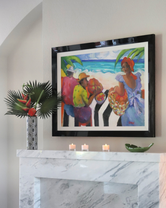 Fireplace with vase of fronds and lighted candles