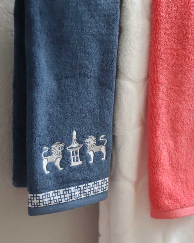 Blue lion and pagoda towels in guest bath