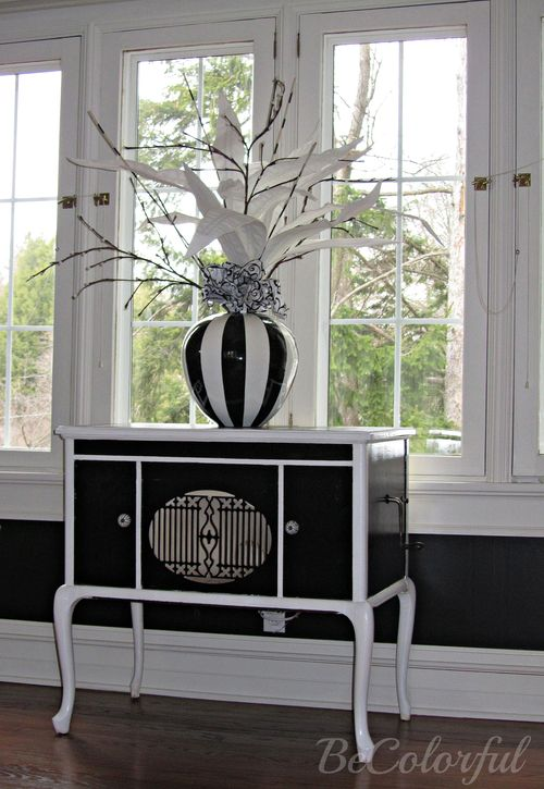 Black and white cabinet in black dining room.jpg